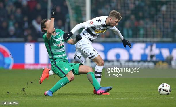 Max Kruse of Werder Bremen and Christoph Kramer oof Moenchengladbach battle for the ball during the Bundesliga match between Werder Bremen and...