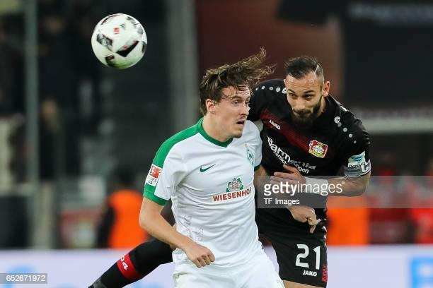 Max Kruse of Werder Bremen and Oemer Toprak of Leverkusen battle for the ball during the Bundesliga soccer match between Bayer Leverkusen and Werder...