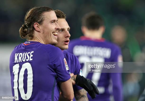 Max Kruse of Werder Bremen and Robert Bauer of Werder Bremen celebrate their win after the Bundesliga match between VfL Wolfsburg and Werder Bremen...
