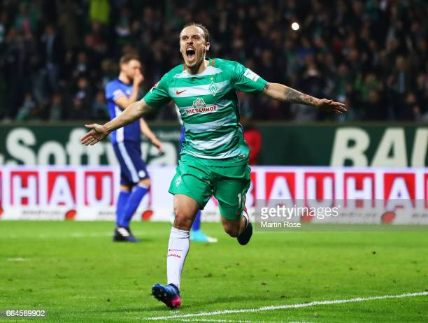 Max Kruse of Werder Bremen celebrates after scoring the second goal during the Bundesliga match between Werder Bremen and FC Schalke 04 at...