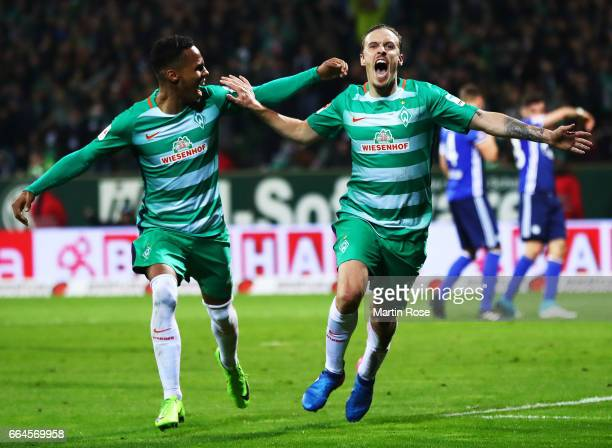 Max Kruse of Werder Bremen celebrates with Theodor Gebre Selassie of Werder Bremen after scoring the second goal during the Bundesliga match between...