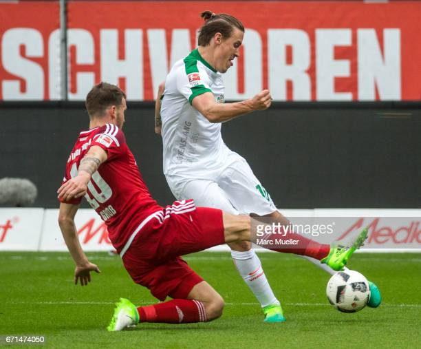 Max Kruse of Werder Bremen is challenged by Pascal Gross of Ingolstadt during the Bundesliga match between FC Ingolstadt 04 and Werder Bremen at Audi...