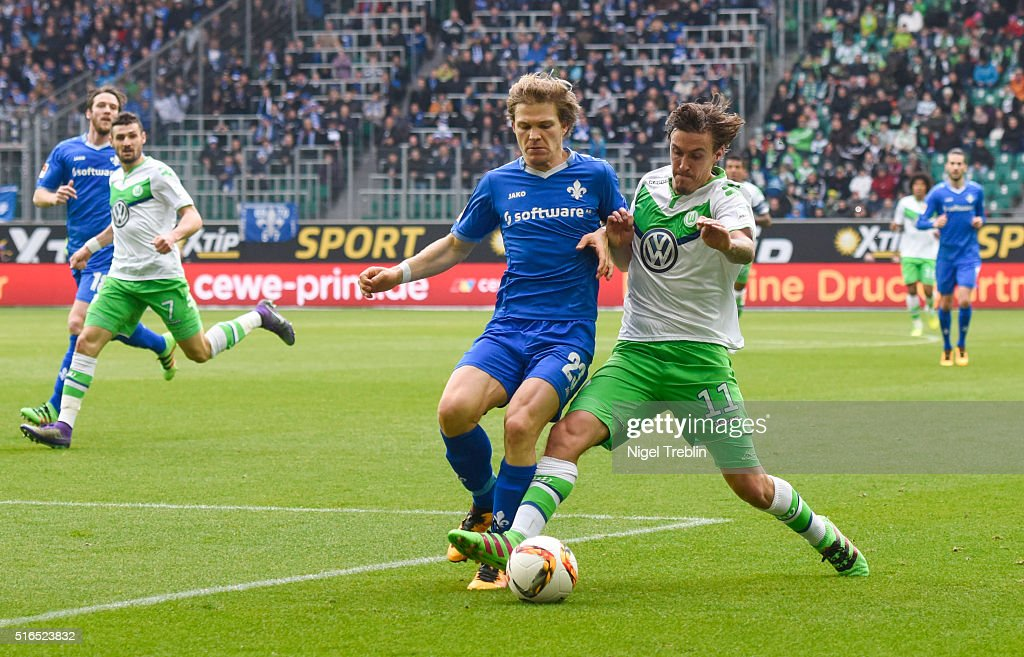 Max Kruse of Wolfsburg is challenged by Florian Jungwirth of Darmstadt during the Bundesliga match between VfL Wolfsburg and Hertha BSC Berlin at Volkswagen Arena on March 19, 2016 in Wolfsburg, Germany.