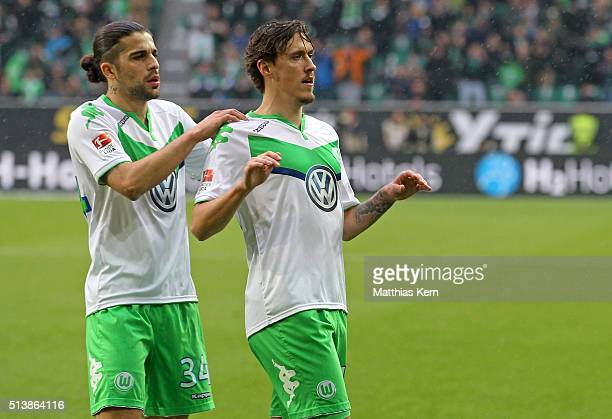 Max Kruse of Wolfsburg jubilates with team mate Ricardo Rodriguez after scoring the second goal during the Bundesliga match between VFL Wolfsburg and...