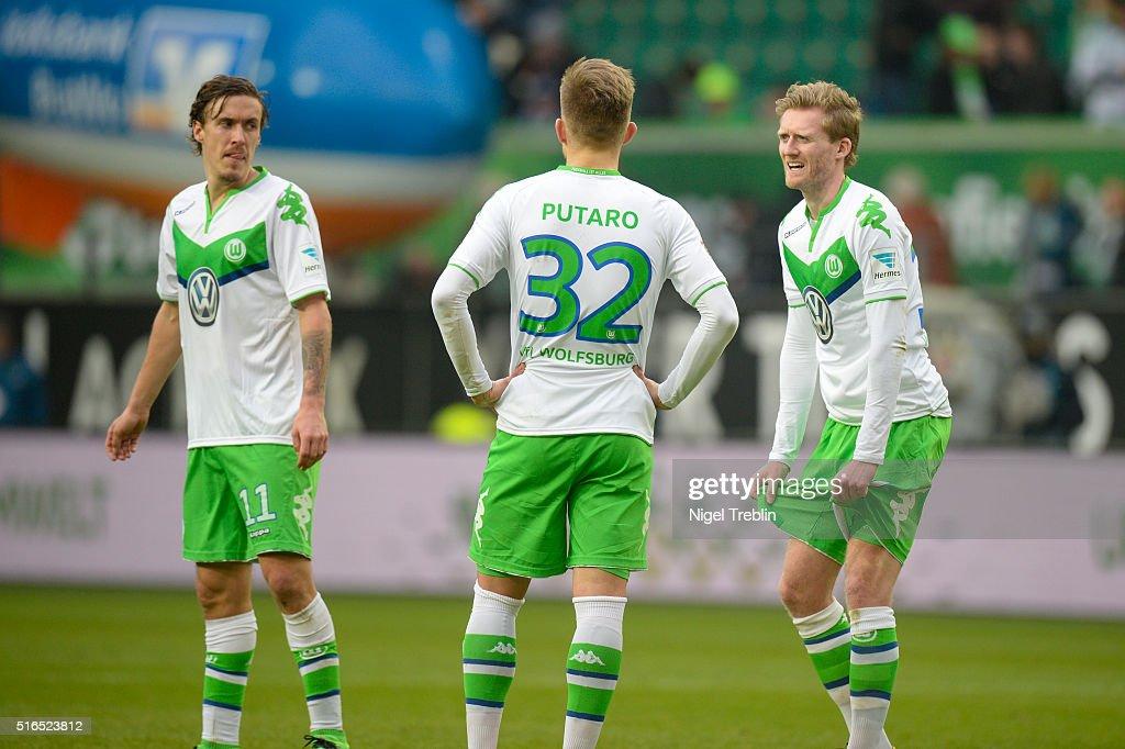 Max Kruse of Wolfsburg, Oskar Zawanda of Wolfsburg and Andre Schuerrle of Wolfsburg react after the Bundesliga match between VfL Wolfsburg and Hertha BSC Berlin at Volkswagen Arena on March 19, 2016 in Wolfsburg, Germany.