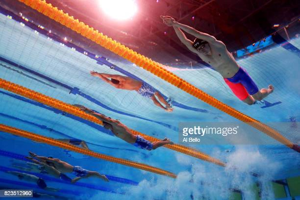 Max Litchfield of Great Britain Chase Kalisz of United States and Kosuke Hagino of Japan competes during the Men's 200m Medley final on day fourteen...