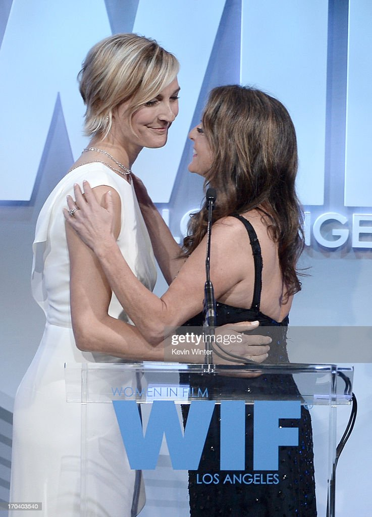 Max Mara executive Nicola Maramotti (L) and President of Women in Film Cathy Schulman speak onstage during Women In Film's 2013 Crystal + Lucy Awards at The Beverly Hilton Hotel on June 12, 2013 in Beverly Hills, California.