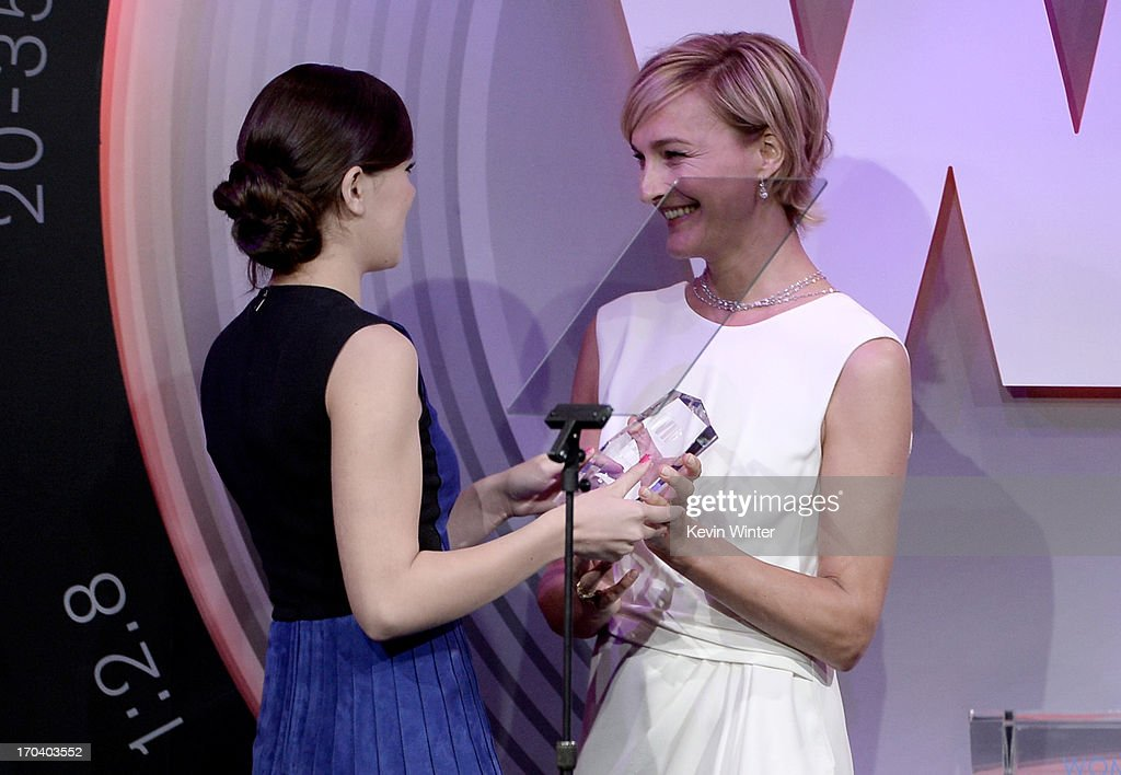 Max Mara executive Nicola Maramotti (R) presents actress Hailee Steinfeld with the 2013 Women In Film Max Mara Face of the Future Award onstage during Women In Film's 2013 Crystal + Lucy Awards at The Beverly Hilton Hotel on June 12, 2013 in Beverly Hills, California.