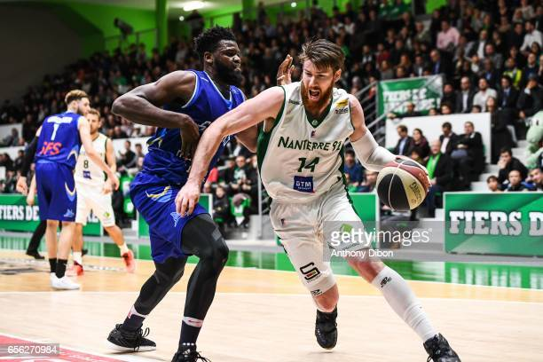 Max Martial Kouguere of Antibes and Brian Conklin of Nanterre during the basketball french cup match between JSF Nanterre and Antibes Sharks on March...