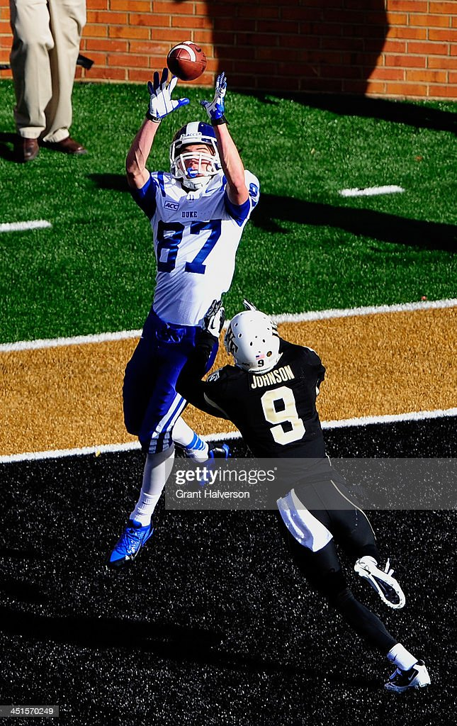 Max McCaffrey #87 of the Duke Blue Devils makes a touchdown catch over Kevin Johnson #9 of the Wake Forest Demon Deacons during play at BB&T Field on November 23, 2013 in Winston Salem, North Carolina.