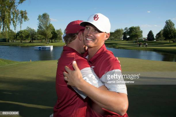 Max McGreevy and Brad Dalke of the University of Oklahoma celebrate during the Division I Men's Golf Team Championship held at Rich Harvest Farms on...