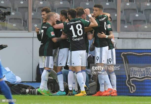 Max Meyer Amine Harit Daniel Caligiuri Leon Goretzka and Franco Di Santo of FC Schalke 04 celebrate after scoring the 01 during the game between...