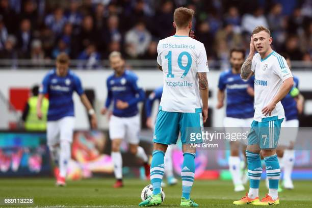 Max Meyer and Guido Burgstaller of Schalke react after Mario Vrancic of Darmstadt scored his team's first goal during the Bundesliga match between SV...
