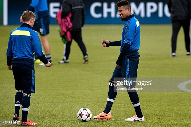 Max Meyer and KevinPrince Boateng joke during a FC Schalke 04 training session prior to their UEFA Champions League Group E match against FC Basel at...