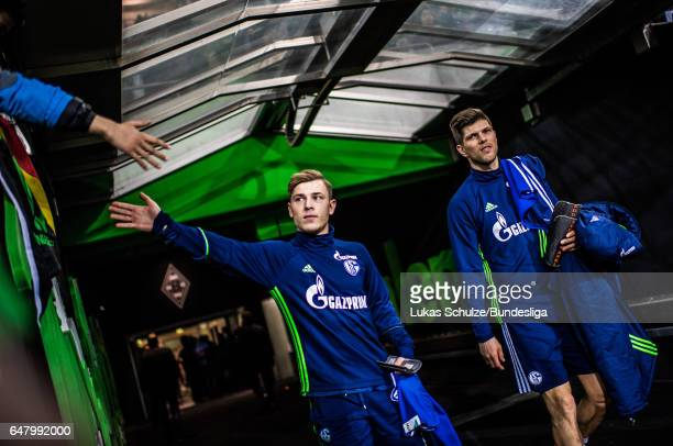 Max Meyer and KlaasJan Huntelaar arrive prior to the Bundesliga match between Borussia Moenchengladbach and FC Schalke 04 at BorussiaPark on March 4...