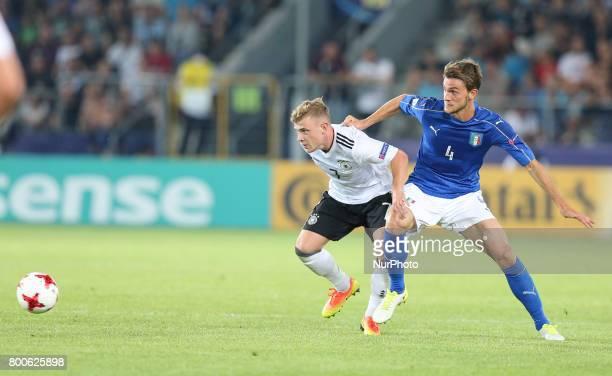Max Meyer Daniele Rugani during the UEFA U21 European Championship Group C football match Italy v Germany in Krakow Poland on June 24 2017