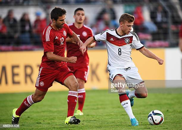 Max Meyer of Germany is challenged by Jakob Blabjerg of Denmark during the International friendly match between U21 Germany and U21 Denmark at...