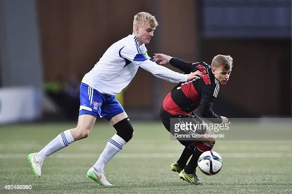 Max Meyer of Germany is challenged by Joannes Biartalio of Faroe Island during the 2017 UEFA European U21 Championships Qualifier between U21 Faroe...