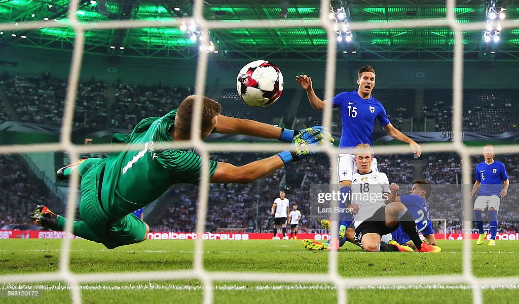 Max Meyer of Germany scores the opening goal past Lukas Hradecky of Finland during the International Friendly match between Germany and Finland at Borussia-Park on August 31, 2016 in Moenchengladbach, Germany.