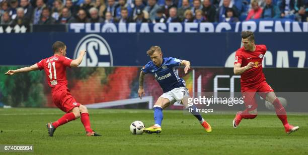 Max Meyer of Schalke and Diego Demme of Leipzig and Marcel Sabitzer battle for the ball during the Bundesliga match between FC Schalke 04 and RB...