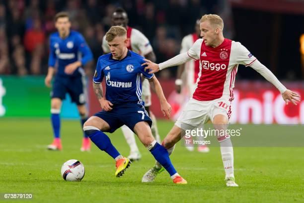 Max Meyer of Schalke and Donny van de Beek of Ajax Amsterdam battle for the ball during the UEFA Europa League Quarter Final first leg match between...