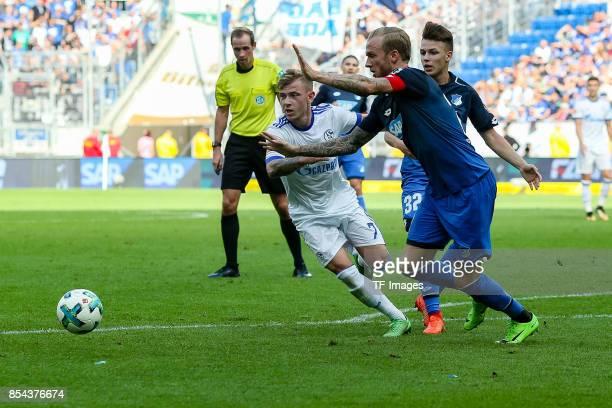 Max Meyer of Schalke and Kevin Vogt of Hoffenheim battle for the ball during the Bundesliga match between TSG 1899 Hoffenheim and FC Schalke 04 at...