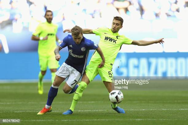 Max Meyer of Schalke battles for the ball with Moritz Leitner of Augsburg during the Bundesliga match between FC Schalke 04 and FC Augsburg at...