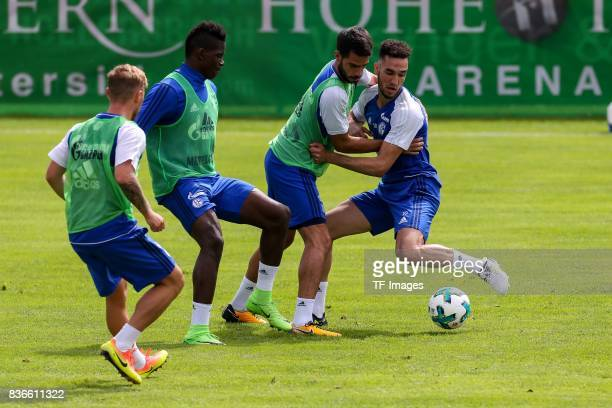 Max Meyer of Schalke Breel Embolo of Schalke Pablo Insua of Schalke Nabil Bentalep of Schalke battle for the ball during the Training Camp of FC...