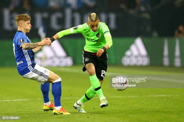 Max Meyer of Schalke challenges Hakim Ziyech of Amsterdam during the UEFA Europa League quarter final second leg match between FC Schalke 04 and Ajax...