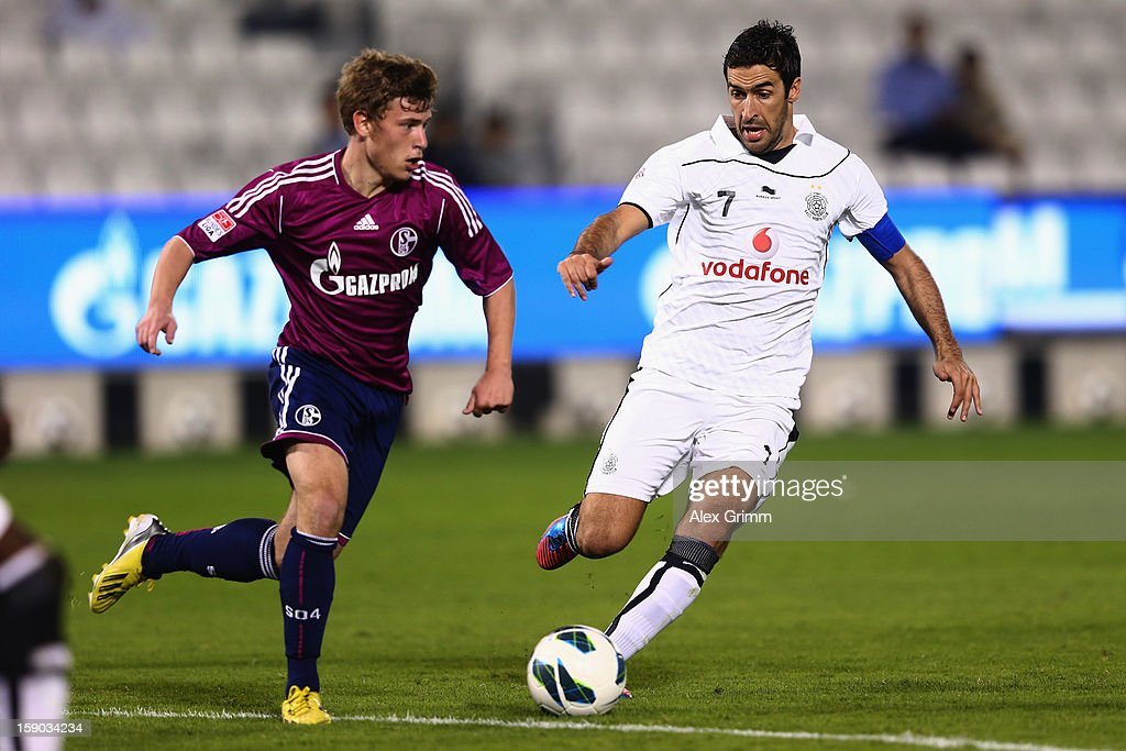 Max Meyer (L) of Schalke is challenged by Raul of Al Sadd during the friendly match between Al-Sadd Sports Club and FC Schalke 04 at Jassim Bin Hamad Stadium on January 6, 2013 in Doha, Qatar.