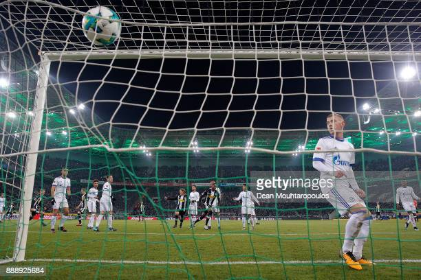 Max Meyer of Schalke looks on after Christoph Kramer of Moenchengladbach scored a goal to make it 10 during the Bundesliga match between Borussia...