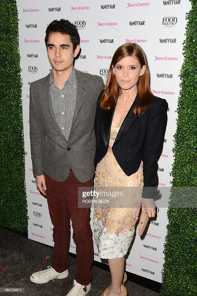 Max Minghella and Kate Mara attend the Vanity Fair And Juicy Couture Celebration Of The 2013 Vanities Calendar party at Chateau Marmont February 18, 2013 in West Hollywood, California. AFP PHOTO Robyn BECK
