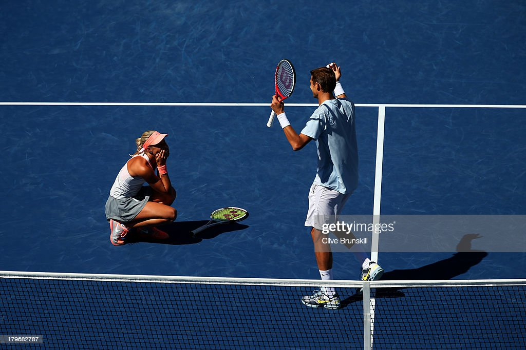 <a gi-track='captionPersonalityLinkClicked' href=/galleries/search?phrase=Max+Mirnyi&family=editorial&specificpeople=171676 ng-click='$event.stopPropagation()'>Max Mirnyi</a> of Belarus and <a gi-track='captionPersonalityLinkClicked' href=/galleries/search?phrase=Andrea+Hlavackova&family=editorial&specificpeople=3378910 ng-click='$event.stopPropagation()'>Andrea Hlavackova</a> of Czech Republic celebrate winning their mixed doubles final match against Abigail Spears of the United States of America and Santiago Gonzalez of Mexico on Day Twelve of the 2013 US Open at USTA Billie Jean King National Tennis Center on September 6, 2013 in the Flushing neighborhood of the Queens borough of New York City.