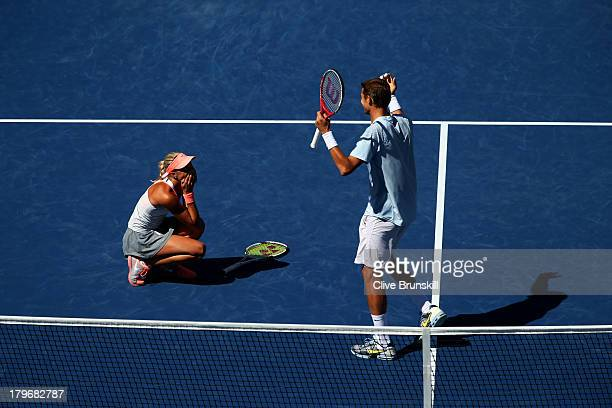 Max Mirnyi of Belarus and Andrea Hlavackova of Czech Republic celebrate winning their mixed doubles final match against Abigail Spears of the United...