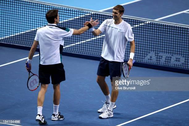 Max Mirnyi of Belarus and Daniel Nestor of Canada celebrate winning the men's doubles final match against Mariusz Fyrstenberg of Poland and Marcin...