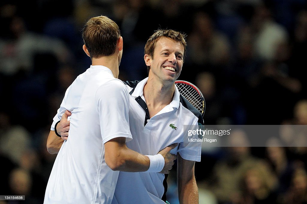 <a gi-track='captionPersonalityLinkClicked' href=/galleries/search?phrase=Max+Mirnyi&family=editorial&specificpeople=171676 ng-click='$event.stopPropagation()'>Max Mirnyi</a> of Belarus and <a gi-track='captionPersonalityLinkClicked' href=/galleries/search?phrase=Daniel+Nestor&family=editorial&specificpeople=212827 ng-click='$event.stopPropagation()'>Daniel Nestor</a> of Canada celebrate winning the men's doubles final match against Mariusz Fyrstenberg of Poland and Marcin Matkowski of Poland during the Barclays ATP World Tour Finals at the O2 Arena on November 27, 2011 in London, England. <a gi-track='captionPersonalityLinkClicked' href=/galleries/search?phrase=Max+Mirnyi&family=editorial&specificpeople=171676 ng-click='$event.stopPropagation()'>Max Mirnyi</a> of Belarus and <a gi-track='captionPersonalityLinkClicked' href=/galleries/search?phrase=Daniel+Nestor&family=editorial&specificpeople=212827 ng-click='$event.stopPropagation()'>Daniel Nestor</a> of Canada won 7-5 6-3.