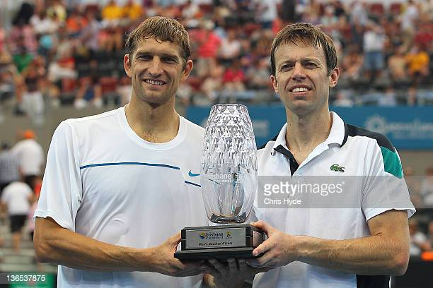 Max Mirnyi of Belarus and Daniel Nestor of Canada hold the winners trophy after winning the Mens doubles final during day eight of the 2012 Brisbane...