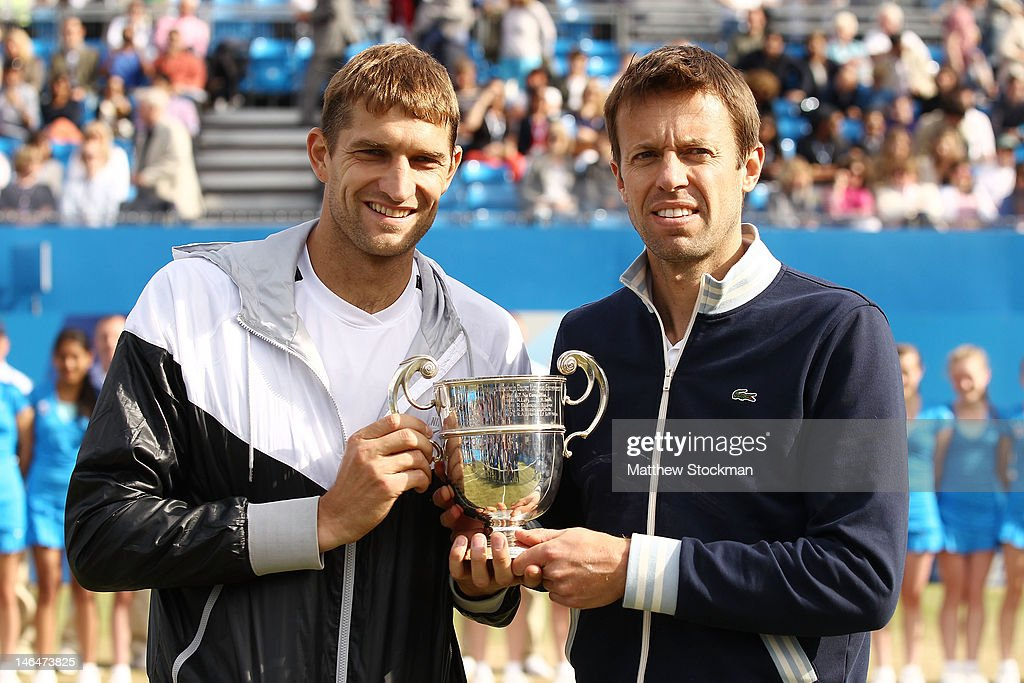 <a gi-track='captionPersonalityLinkClicked' href=/galleries/search?phrase=Max+Mirnyi&family=editorial&specificpeople=171676 ng-click='$event.stopPropagation()'>Max Mirnyi</a> of Belarus and <a gi-track='captionPersonalityLinkClicked' href=/galleries/search?phrase=Daniel+Nestor&family=editorial&specificpeople=212827 ng-click='$event.stopPropagation()'>Daniel Nestor</a> of Canada hold up their winner's trophy after winning their mens double final round match against Bob Bryan and Mike Bryan of the USA on day seven of the AEGON Championships at Queens Club on June 17, 2012 in London, England.
