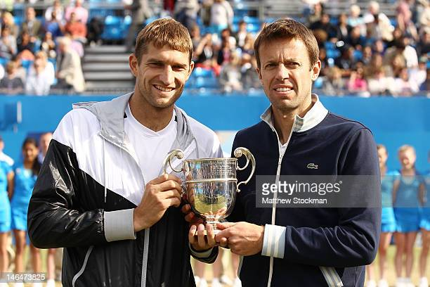 Max Mirnyi of Belarus and Daniel Nestor of Canada hold up their winner's trophy after winning their mens double final round match against Bob Bryan...