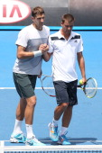 Max Mirnyi of Belarus and Mikhail Youzhny of Russia celebrate winning their third round doubles match against Eduardo RogerVasselin of France and...