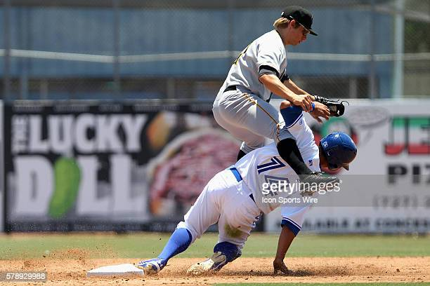 Max Moroff of the Marauders leaps and lands atop of Christian Lopes of the Blue Jays after attempting to get out of the way of Lopes during the...