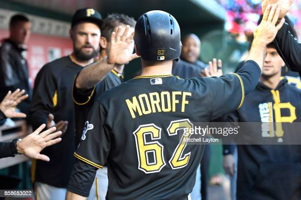 Max Moroff of the Pittsburgh Pirates celebrates scoring a run during a baseball game against the Washington Nationals at Nationals Park on October 1...