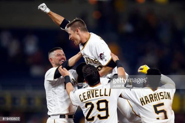 Max Moroff of the Pittsburgh Pirates celebrates with teammates after hitting a walk off single in the tenth inning against the Milwaukee Brewers at...