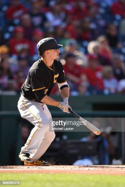 Max Moroff of the Pittsburgh Pirates doubles in two runs in the first inning during a baseball game against the Washington Nationals at Nationals...