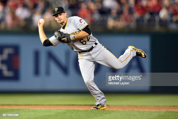 Max Moroff of the Pittsburgh Pirates fields a ground ball during a baseball game against the Washington Nationals at Nationals Park on September 28...