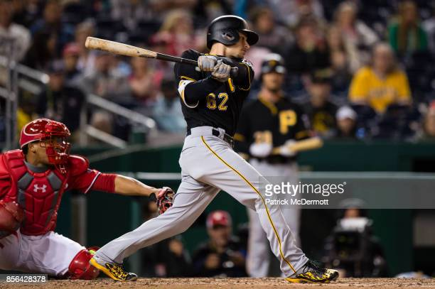Max Moroff of the Pittsburgh Pirates hits a threerun RBI triple in the ninth inning against the Washington Nationals at Nationals Park on September...
