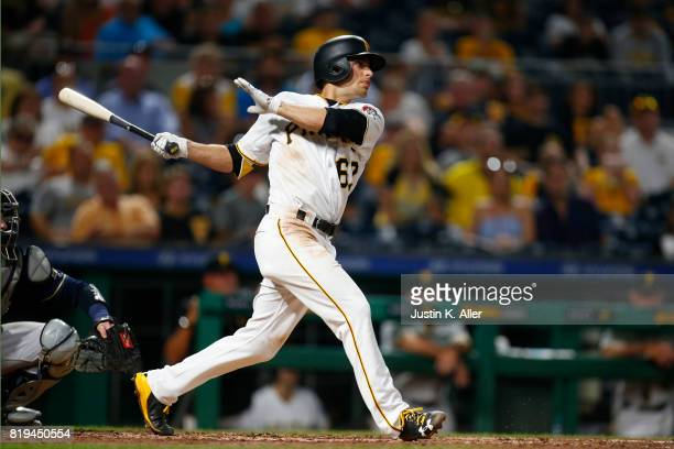 Max Moroff of the Pittsburgh Pirates hits a walk off single in the tenth inning against the Milwaukee Brewers at PNC Park on July 19 2017 in...