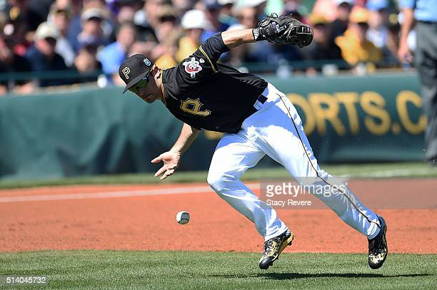Max Moroff of the Pittsburgh Pirates misplays a ground ball during the first inning of a spring training game against the Houston Astros at McKechnie...