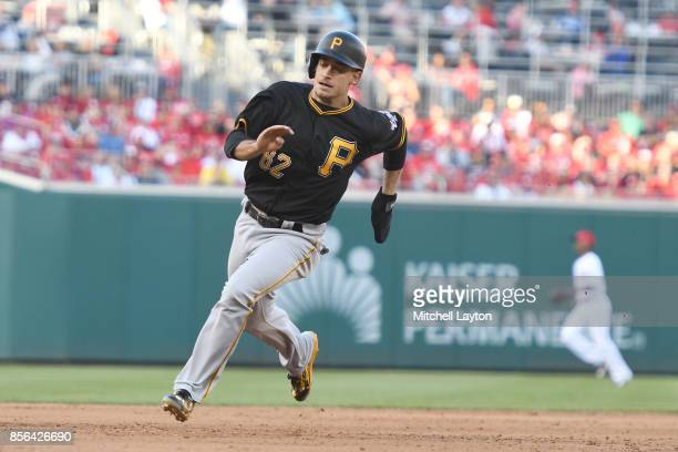 Max Moroff of the Pittsburgh Pirates rounds third base and score on Jacob Stallings of the Pittsburgh Pirates double in the fifth inning during a...