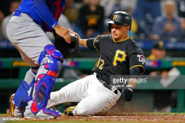 Max Moroff of the Pittsburgh Pirates scores on a RBI single in the eighth inning against the Chicago Cubs at PNC Park on September 5 2017 in...